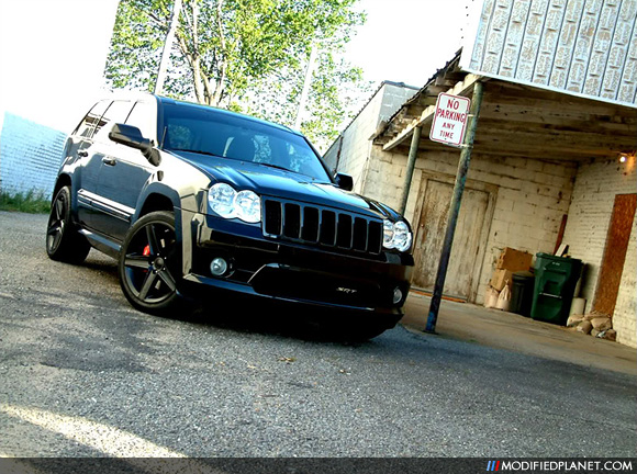 The blacked out color scheme of this 2009 Jeep Grand Cherokee SRT8 takes