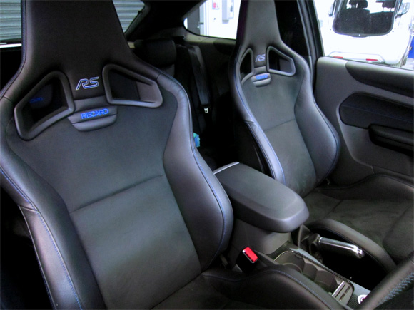 Car photo of a 2011 ford focus rs interior featuring a set of