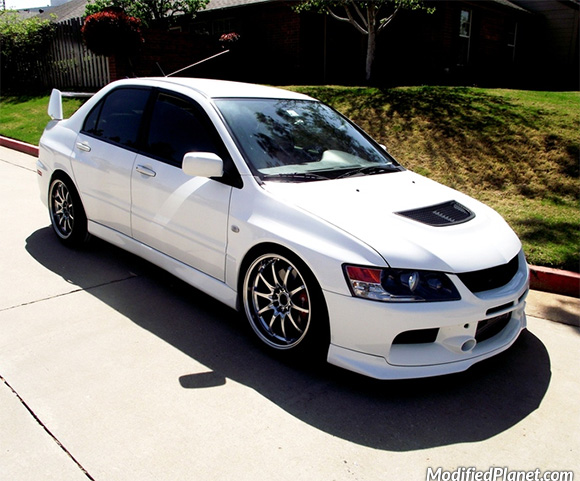 2006 Mitsubishi Evo 9 sitting on a set of hyper black 18″ x 9 ...