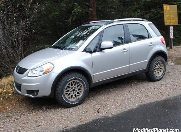car-photo-2008-suzuki-sx4-hatchback-1994-jeep-grand-cherokee-limited-wheels