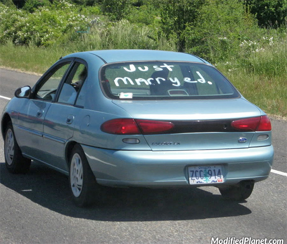 car-photo-1998-ford-escort-sedan-just-marryed-married-spelling-fail